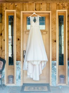 Stunning a-line wedding dress with cutout back. View the full wedding here: http://thedailywedding.com/2016/06/18/whimsical-lawn-wedding-katherine-matt/