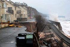 Homes evacuated and mainline railway destroyed as sea wall at Dawlish in Devon collapses, leaving the far west of England cut off for rail travel.
