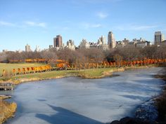 "The Gates was a site-specific work of art by Christo and Jeanne-Claude. The artists installed 7,503 vinyl ""gates"" along 23 miles (37 km) of pathways in Central Park in New York City. From each gate hung a panel of deep saffron-colored nylon fabric. The exhibit ran from February 12, 2005 through February 27, 2005."