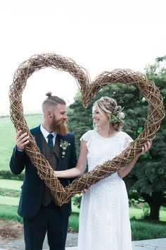 Bride and groom with a giant willow heart. Rustic wedding inspiration