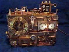 I just watched a video of this steampunk clock in action, & it took 10 WHOLE MINUTES to show off all the different switches, lights, music boxes, and whirly bits. AMAZING.