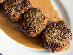 Jan 2018 - Classic steak au poivre is a simple dish of seared peppercorn-crusted steaks with a creamy pan sauce. The secret to the best results? Start by encrusting the steaks on only one side. Au Poivre Sauce, Steak Au Poivre, Beef Medallions, Peppercorn Sauce For Steak, Pepper Sauce For Steak, Steak Toppings, How To Make Steak, Recipes, French Tips