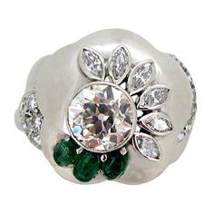 1960s Seaman Schepps Diamond Emerald Flower Ring  | From a unique collection of vintage cocktail rings