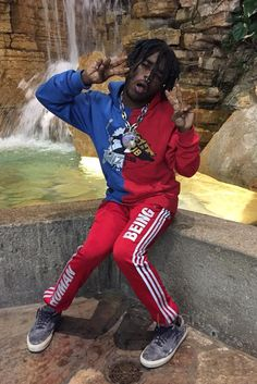 Lil Uzi Vert wearing Off-White c/o Virgil Abloh Midnight Studios Reassembled Hoody, Vans Suede Woven Old Skool Sneakers, Adidas Pharrell Williams Human Being Sweatpants
