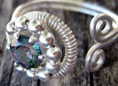 Adjustable Hand-Formed Ring    Materials: Silver Plated, Natural Rainbow Topaz Set in Sterling Silver