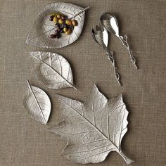 Fall Leaves Serving Platters - Symbolizing autumn's beauty, our Maple Leaf Serving Platter and 3-piece Leaf Serving Platters (sold separately) are crafted of metal and intricately embossed to highlight every detail. It's special touches, such as these, that delight guests and make your table beautiful.