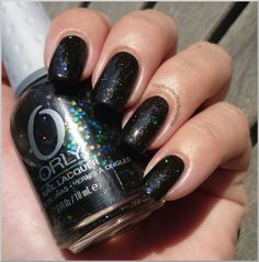 Androgynie is a black jelly with large multi-coloured hexagons, finer prismatic glitter and really fine gold flecks.