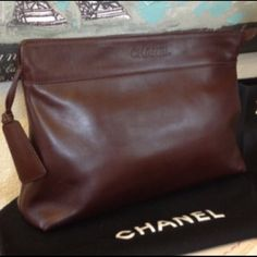 New! Chanel Chocolate Brown Clutch. Large! Beautiful Chanel clutch! This gorgeous bag is brand new, only taken out of the dust bag to admire once & awhile. The leather is so soft, you'll want to sleep on it. It's a great big size for a clutch, some of us need more than a phone & lip gloss to hit the town. Zip closure with 2 inside zip pockets.  Took me a year to decide to sell it. Perfect for fall. CHANEL Bags Clutches & Wristlets
