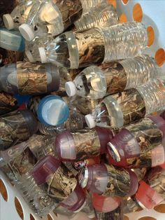Drinks decorated with camo duct tape for a hunting theme birthday party.