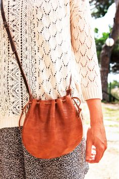 Vintage leather bag. Small leather handbag with cross-body strap. Cowhide tote Bag. Several brown tones. With inside pocket. Cord closure and adjustable