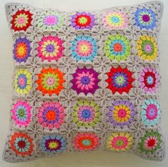 the 25 colors in beige granny square cushion by handmadebyria
