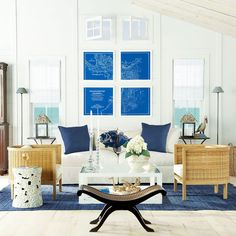 Wisteria blue and white living room lighting with very skinny floor lamps
