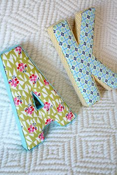 Fabric Letters {tutorial} Playful fabric letters made easy in this tutorial! Coordinate the fabric to match your room. And make lots of these because they make the perfect gift: handmade and custom. Fabric Crafts, Sewing Crafts, Sewing Projects, Craft Projects, Craft Ideas, Fabric Covered Letters, Fabric Letters, Wooden Letters, Diy Letters