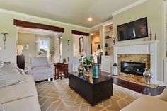 Crisp white trim and wood accents create an inviting great room. New homes in the Germany Oaks community built by Level Homes in Prairieville, LA.