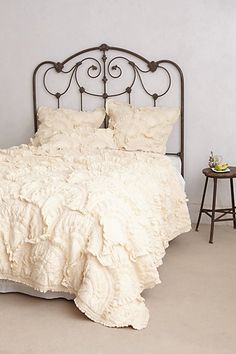 I love the look of white bedding. The ruffles add texture, while the color gives the bed a bright and airy feel.
