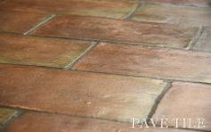 Brick look floor tile....love it!  Please get this 'it never stays clean' white tile out and this IN! :-/  please? :)