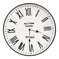 The classic charm of the Stratton Home Decor Metal Enamel Parker Wall Clock makes it an excellent addition to any room. Amply sized black Roman numerals against a crisp-white dial offers timeless appeal and makes reading the time easy from almost Old Town Clock, Old Clocks, Antique Clocks, White Wall Clocks, Clock Wall, Farmhouse Wall Clocks, How To Make Wall Clock, Clock Decor, Wall Decor