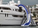 Yacht with a FreeStyle Cruiser inflatable water slide. #Yachts #YachtToys #YachtWaterToys