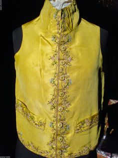 Waistcoat, France, late 18th century. Yellow silk embroidered with floral garlands and flowers in coloured silk thread.