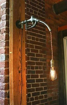 Gas handle light. Steampunk Interior Designs We Love at Design Connection, Inc. | Kansas City Interior Design http://designconnectioninc.com/blog/ #InteriorDesign #Steampunk