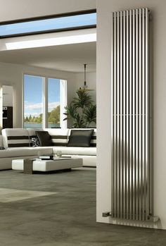 Reina Odin stainless steel radiator with a satin finish, is a sleek vertical square tubed radiator, this will look stylish in any modern lounge or kitchen. It is or in height and comes with a 25 year guarantee. Prices from Tall Radiators, Flat Panel Radiators, Bathroom Radiators, Column Radiators, Modern Radiators, Horizontal Designer Radiators, Vertical Radiators, Wakefield, Large Radiator Covers