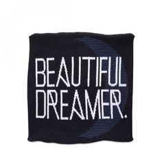 There is nothing more beautiful than a sleeping baby enjoying sweet dreams! DittoHouse's Beautiful Dreamer Pillow Cover is the perfect addition to any nursery. Graphic white letters against a dark charcoal ground with a blue crescent moon, this pillow cover is striking and lovely. Pillow insert not included. 18 x 18 inches. 80% Recycled Cotton / 20% Polyester. Machine wash and dry.