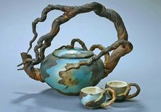 Arching Branch Teapot with 2 cups Ship Date: weeks Hand-thrown with sculpted clay handle, interior water-proof glaze, underglazed and smoke fired finish. x About the Artist: Bonnie Belt