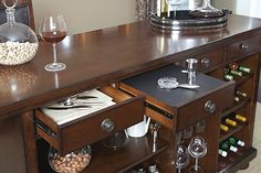 home bar? yes please! so much storage space...  Porter Bar Ashley Furniture Homestore