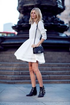 pair a femenine dress with some edgy boots
