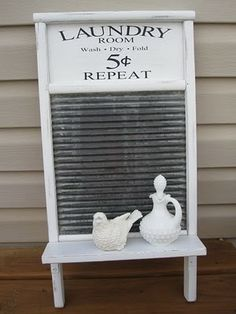 Love the look of the white and the vinyl lettering...have a washboard with broken glass...want to insert a chalkboard into the main part and hang in the laundry room
