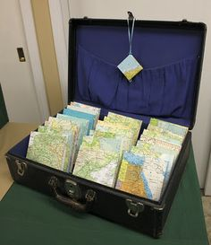 travel journals in a vintage suitcase display, love it!