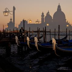 David duChemin has very good photos- one of my favorites being of his photos of Venice.