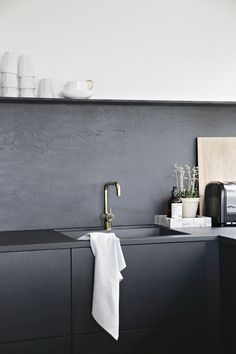 really like the cupboards and the black look.  more contemporary than white.