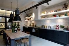 Kitchen Design Inspiration Industrial chic kitchen with black cabinets and white shelves with large vintage industrial lights, white subway tiles Industrial Chic Kitchen, Loft Industrial, Loft Kitchen, Shabby Chic Kitchen, Industrial Interiors, Kitchen Interior, New Kitchen, Kitchen Ideas, Industrial Bathroom