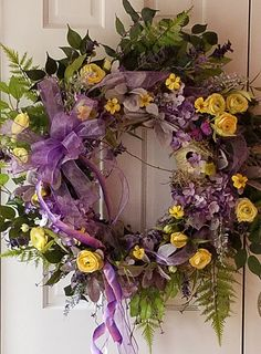 You Gotta Love Purple Wreath Is just breathtaking with its Purple Hydrangeas, Yellow Rununculus, Yellow Pansies and soft lambs ear (Stachys)! Hang it up and show everyone spring is on the way. Ive also associated the colors of this wreath with Easter! A celebration of love and