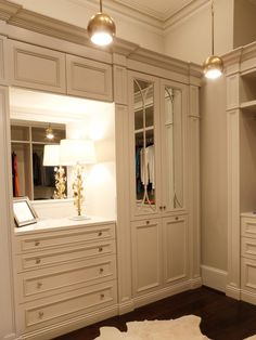 A room in the 2013 Atlanta Decorators Show House, a showcase of more than 30 spaces transformed by designers from around the Southeast, this master bedroom closet is a large space with plenty of storage for clothing and accessories.