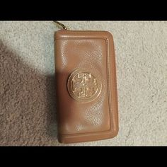 Tory Burch Wallet Beautiful tan leather authentic Tory wallet with gold and leather logo and gold zipper.  Perfect condition!!  Inside zip pocket continental style.  NO TRADES Tory Burch Bags Wallets