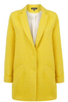 This relaxed fit coat features press-button closures, two front pockets, oversized fit and textured boucle finish