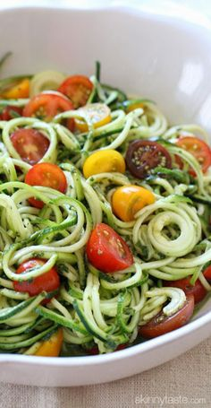 Raw spiralized zucchini noodles with tomatoes and pesto. I combined all of my favorite end-of-summer garden vegetables and created this simple, raw spiralized zucchini and pesto dish. Raw Food Recipes, Salad Recipes, Vegetarian Recipes, Cooking Recipes, Healthy Recipes, Vegetarian Dish, Noodle Recipes, Ketogenic Recipes, Freezer Recipes