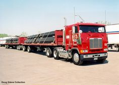 Freightliner with twin 48' spread axle trailers.