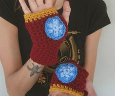 Iron Man Knitted Hand Warmers  Keep your hands nice and toasty like a true Marvel fan with these one of a kind Iron Man knitted hand warmers. Each skillfully knitted hand warmer comes accented with blue yarn blasters in each palm and features thumbholes to allow for maximum practicality.  $14.00  Check It Out  Awesome Sht You Can Buy