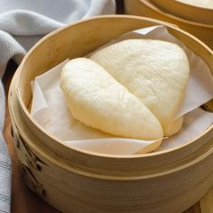Asian Steamed Buns in a bamboo steamer.