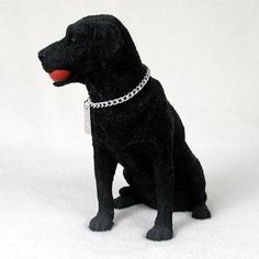 This black Labrador Retriever dog figurine is a little larger than the standard size dog figurines. It measures about 7 x 7 x 7 inches and is hand painted stone resin. My dog figurines have a silver t