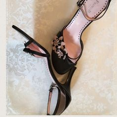 """Italian Leather Sandals Black w/light pink Exquisite Black Italian leather sandals with a delicate pink flower detail. Excellent condition worn only once, wear is only on the bottom. 2"""" heel measuring from the bottom of the shoe. See photo. Listed on Mercr! For less. Search Faye Vitt or black Italian leather sandals. Use code YJXDWY when downloading for $2 off Franco Barbieri Shoes Sandals"""