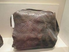 This is a viking age carved leather bag and it belongs to the National Museum in Ireland.