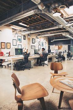 The Workspace of Welikesmall. Great example of how to incorporate art and photography into an office or workspace.: