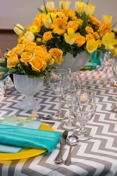 Yellow centerpieces and chevron table cloth