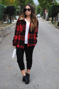 Shop this look on Lookastic:  http://lookastic.com/women/looks/crew-neck-t-shirt-jacket-clutch-sweatpants-oxford-shoes-sunglasses/5684  — White Crew-neck T-shirt  — Red and Black Plaid Jacket  — White Leather Clutch  — Black Sweatpants  — Black Chunky Leather Oxford Shoes  — Black Sunglasses
