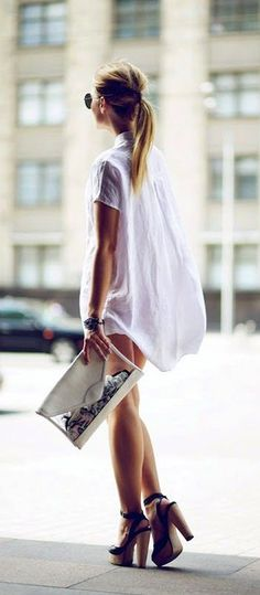 loose white blouse and beautiful heels.