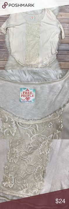 "Free People Lace Dolman Tee Excellent condition Free People cream Lace dolman tee. Cotton. Size XS. Front Lace panel. Bust 48"", length 27"". Short sleeves. Pink things you see are to hang it on a hanger. No trades, offers welcome. Free People Tops Tees - Short Sleeve"
